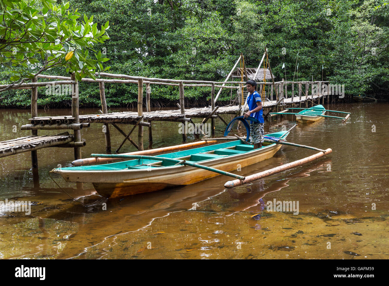 Filipino Outrigger - An outrigger is a part of a boat's rigging which is rigid and extends beyond the side or - Stock Image