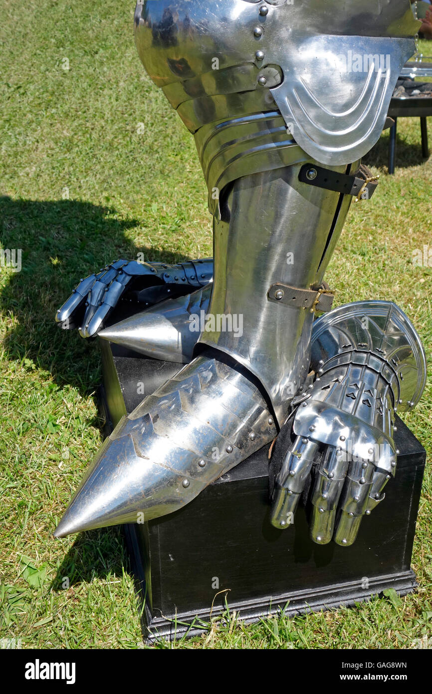 Details of plate armour that includes a Pointed toe sabatons, greave and gauntlets. - Stock Image