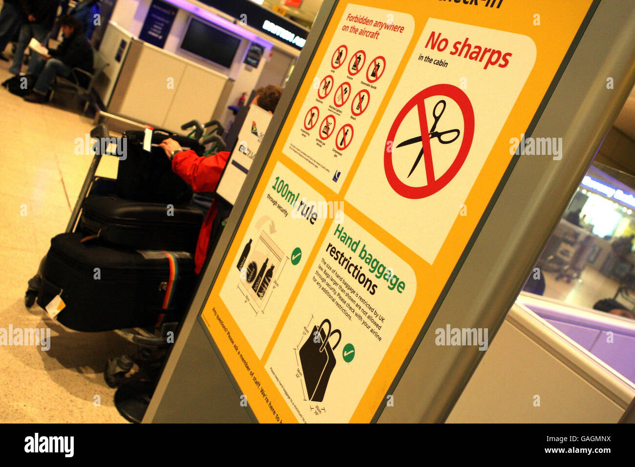 Airports 'coping well' with new baggage rules - Stock Image