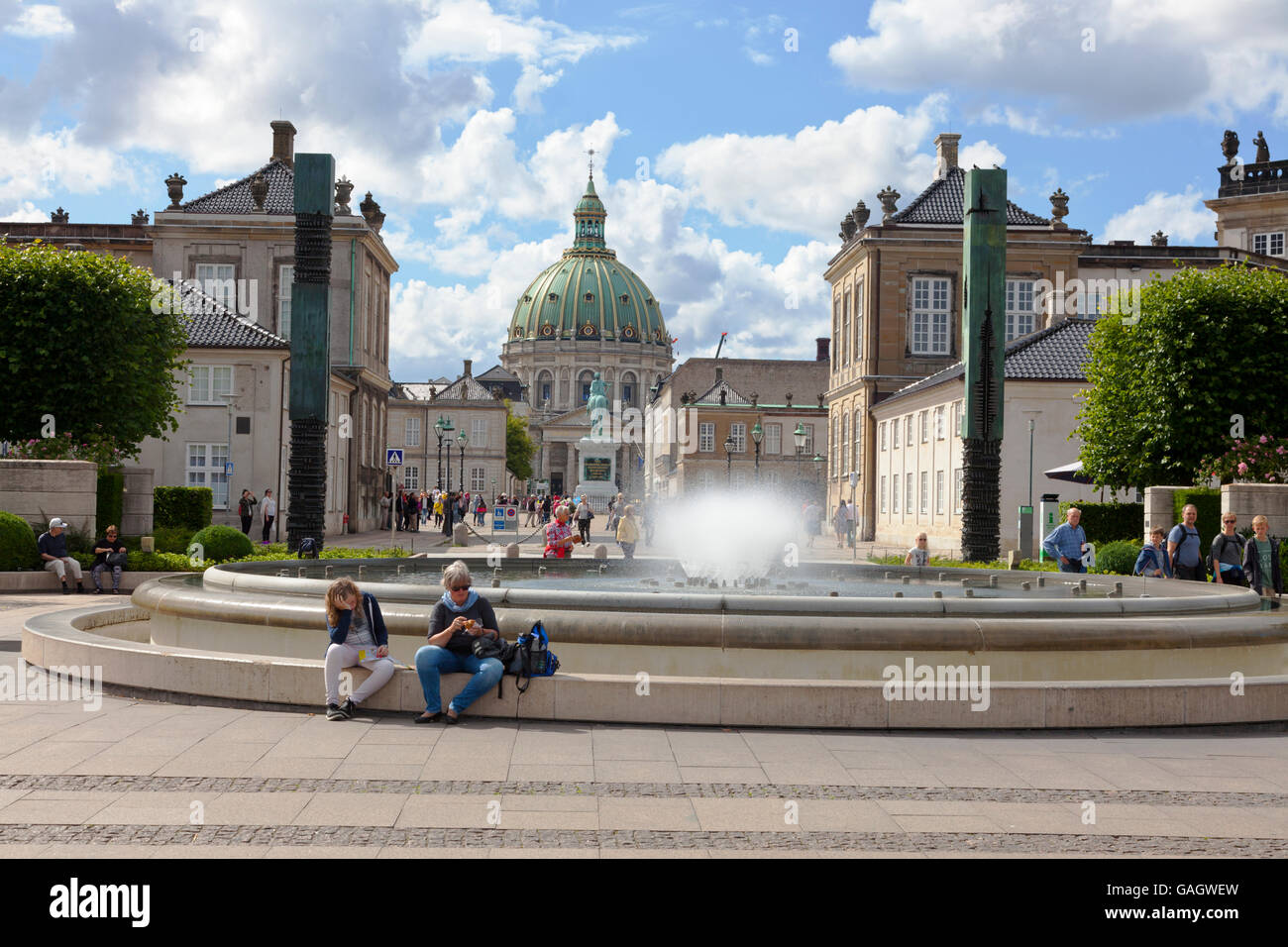 The fountain in Amaliehaven, the Amalienborg Palace and last the Marble Church seen from the waterfront on a sunny - Stock Image