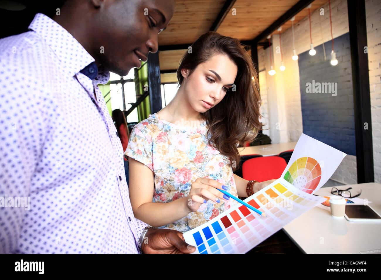 Group of Multiethnic Designers Brainstorming - Stock Image
