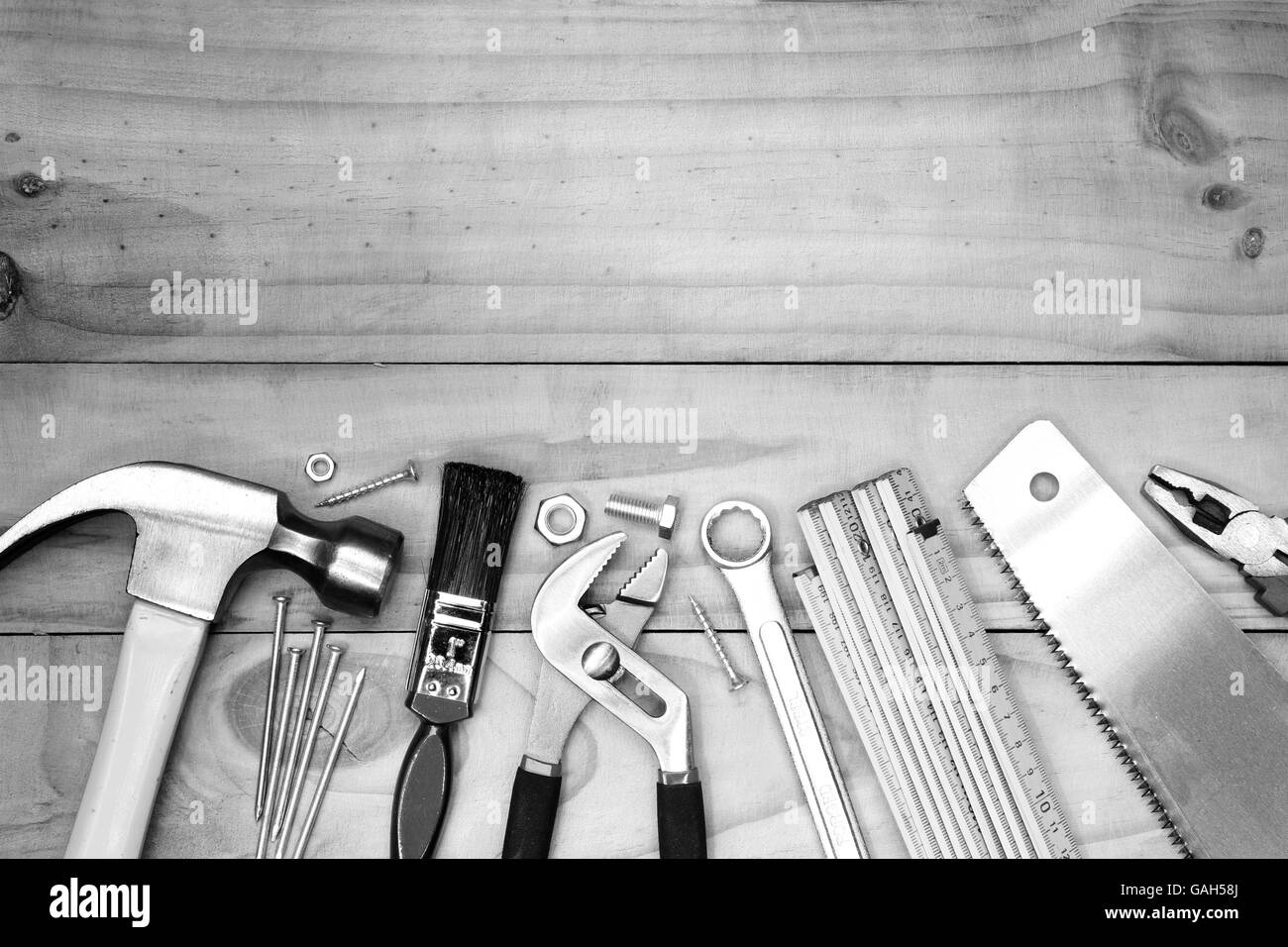 Assorted work tools on wood - Stock Image
