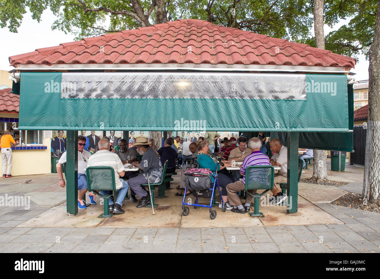 MIAMI, FLORIDA - APRIL 25, 2016: Game players at historic Domino Park along Calle Ocho in Little Havana. - Stock Image