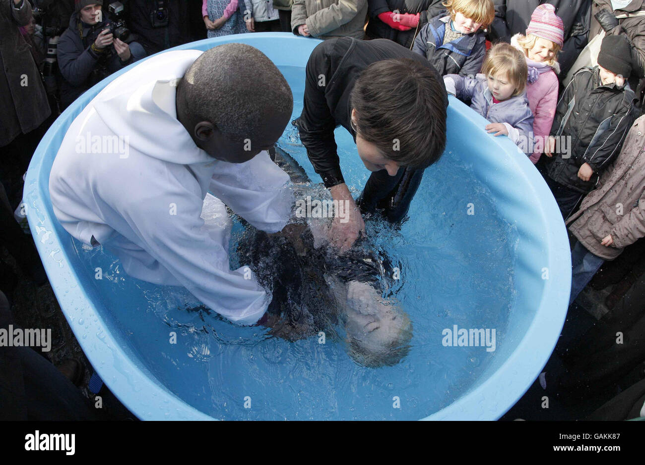 Christians take the plunge - Stock Image