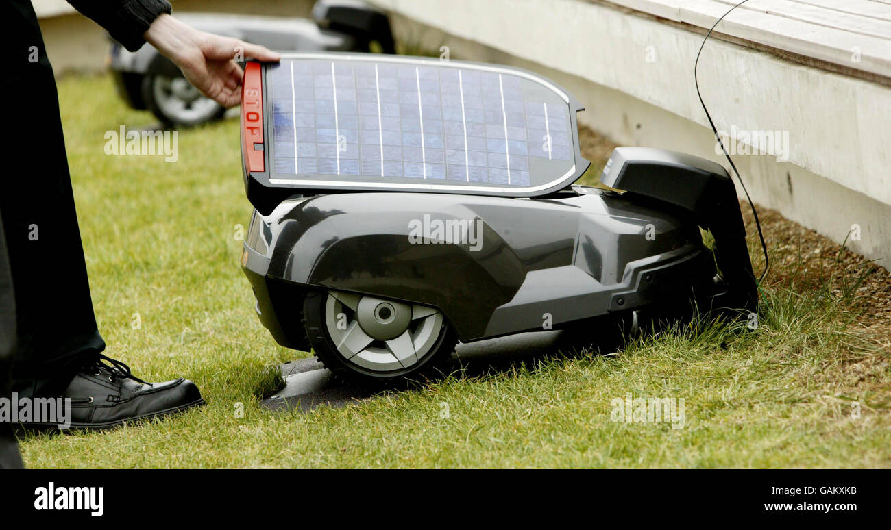 Zero emission solar powered lawn mower launch - Stock Image