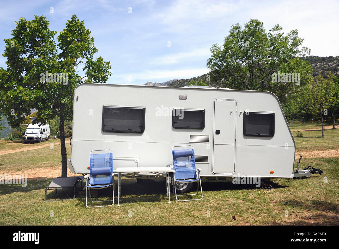 Caravan At A Camping With Two Camping Chairs In Front   Stock Image