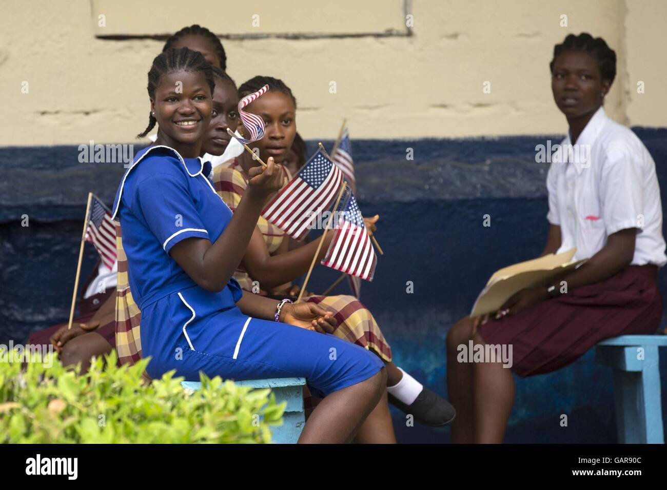 Liberian school girls welcome wait to welcome U.S. First Lady Michelle Obama on arrival at Monrovia Roberts International - Stock Image
