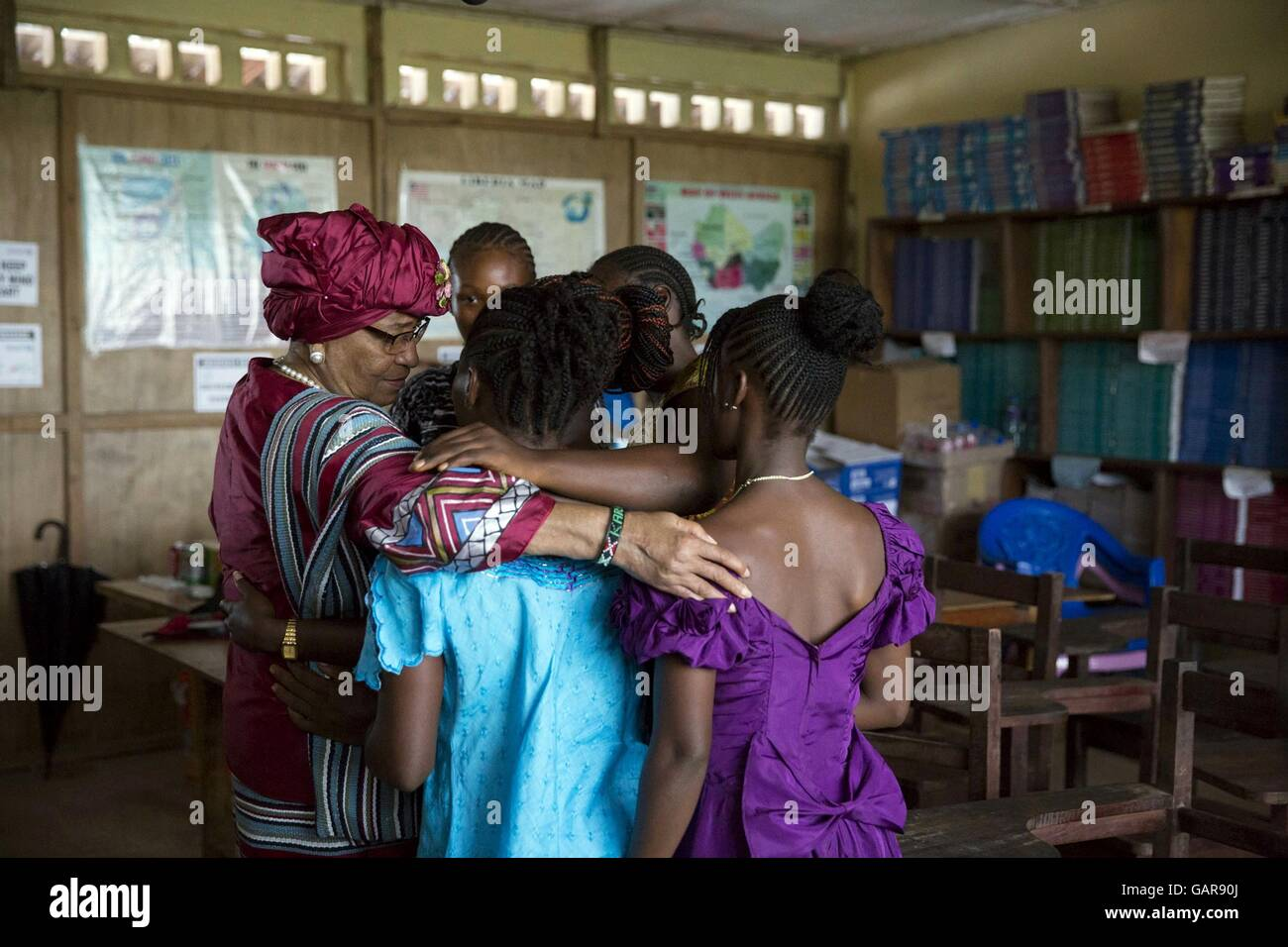 Liberian President Ellen Johnson Sirleaf hugs students prior to a Let Girls Learn roundtable discussion at R.S. - Stock Image