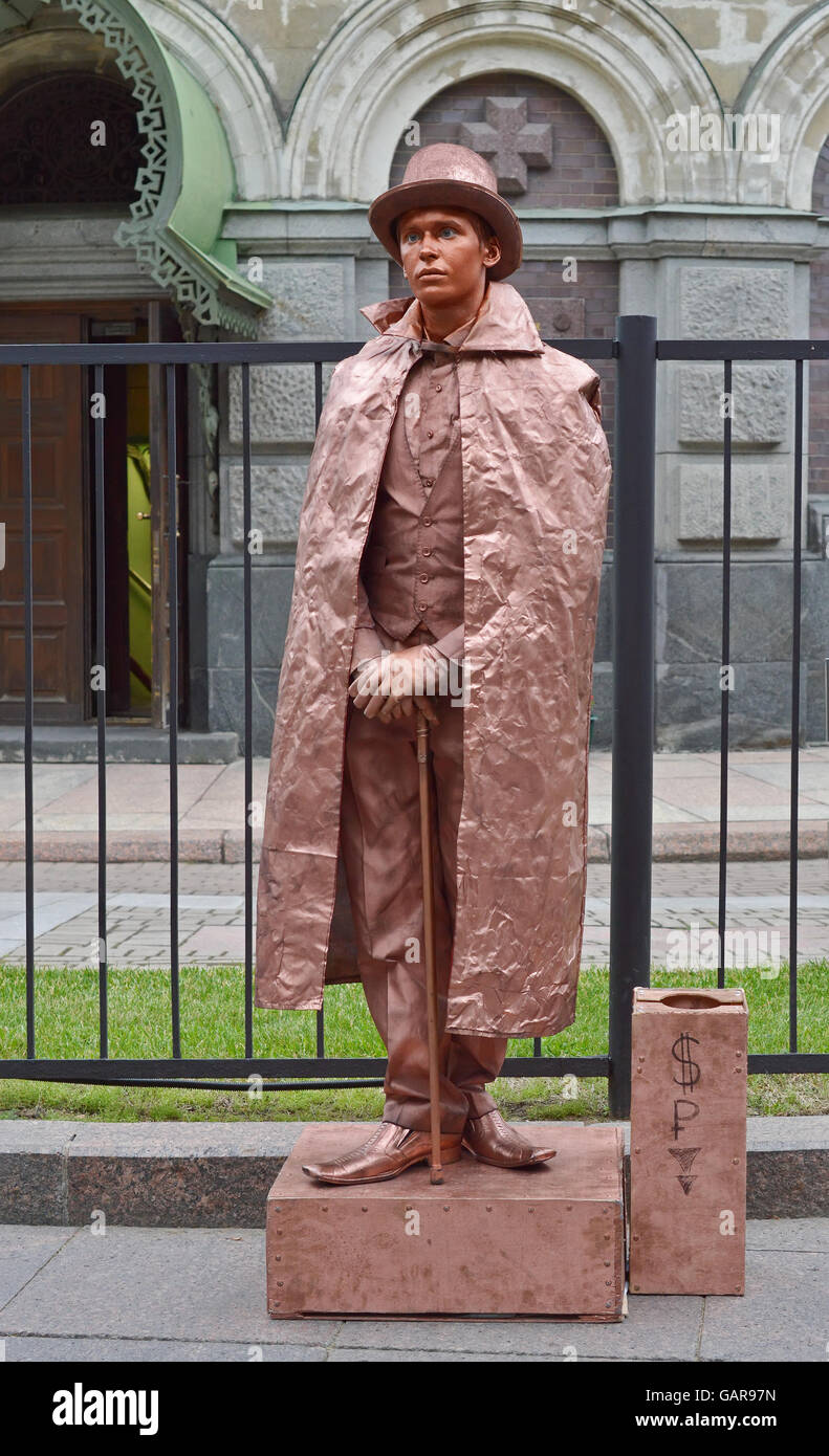 Street actor - mime in an image of statues representing the gentleman in retro.  St. Petersburg July 1, 2016. - Stock Image
