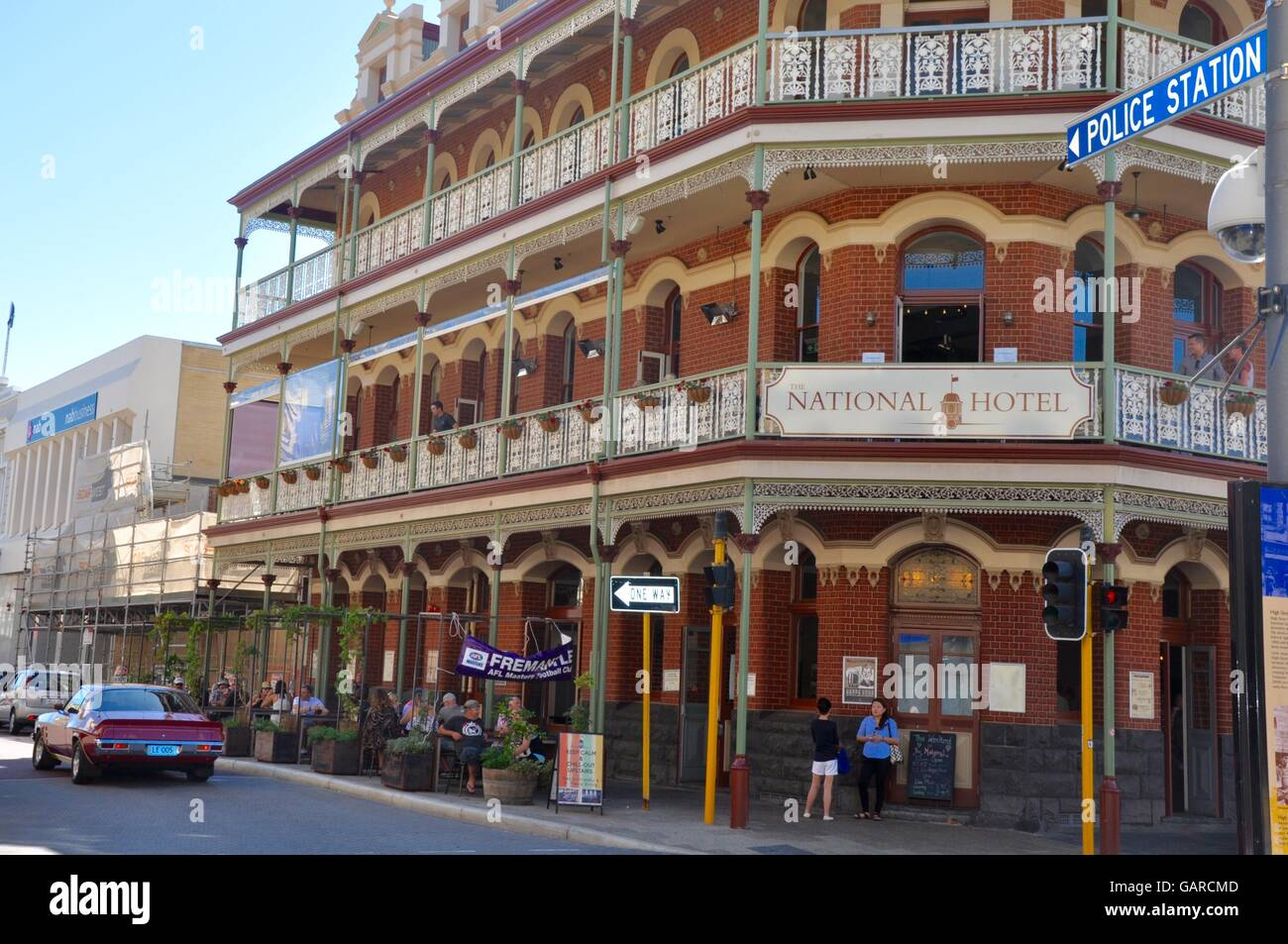 fremantlewaaustralia february 212015 national hotel with brick architecture balconies outdoor seating and people in fremantlewestern australia