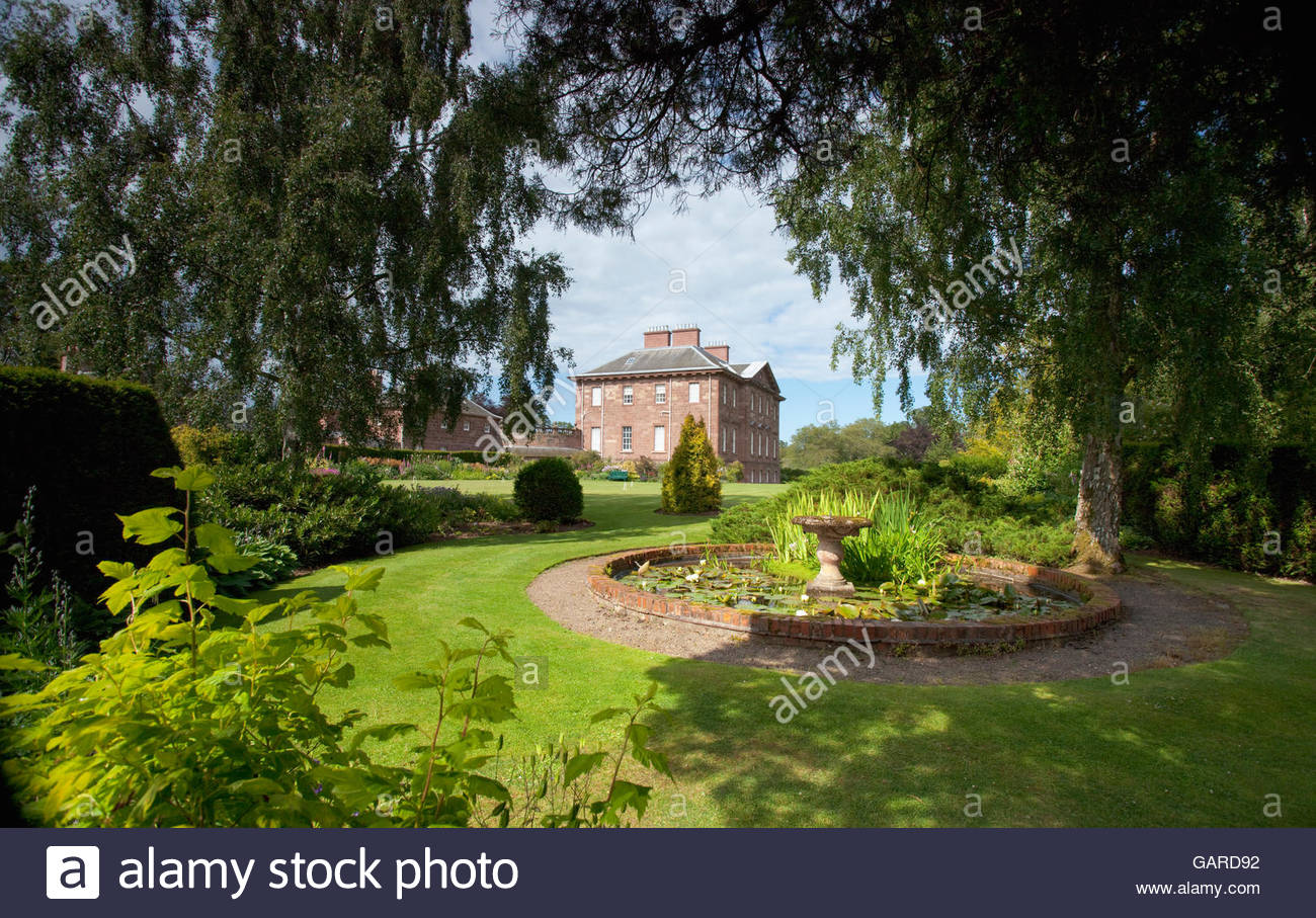 Looking over an ornamental pond to Paxton House - a stately home in the Scottish Borders, Scotland. - Stock Image