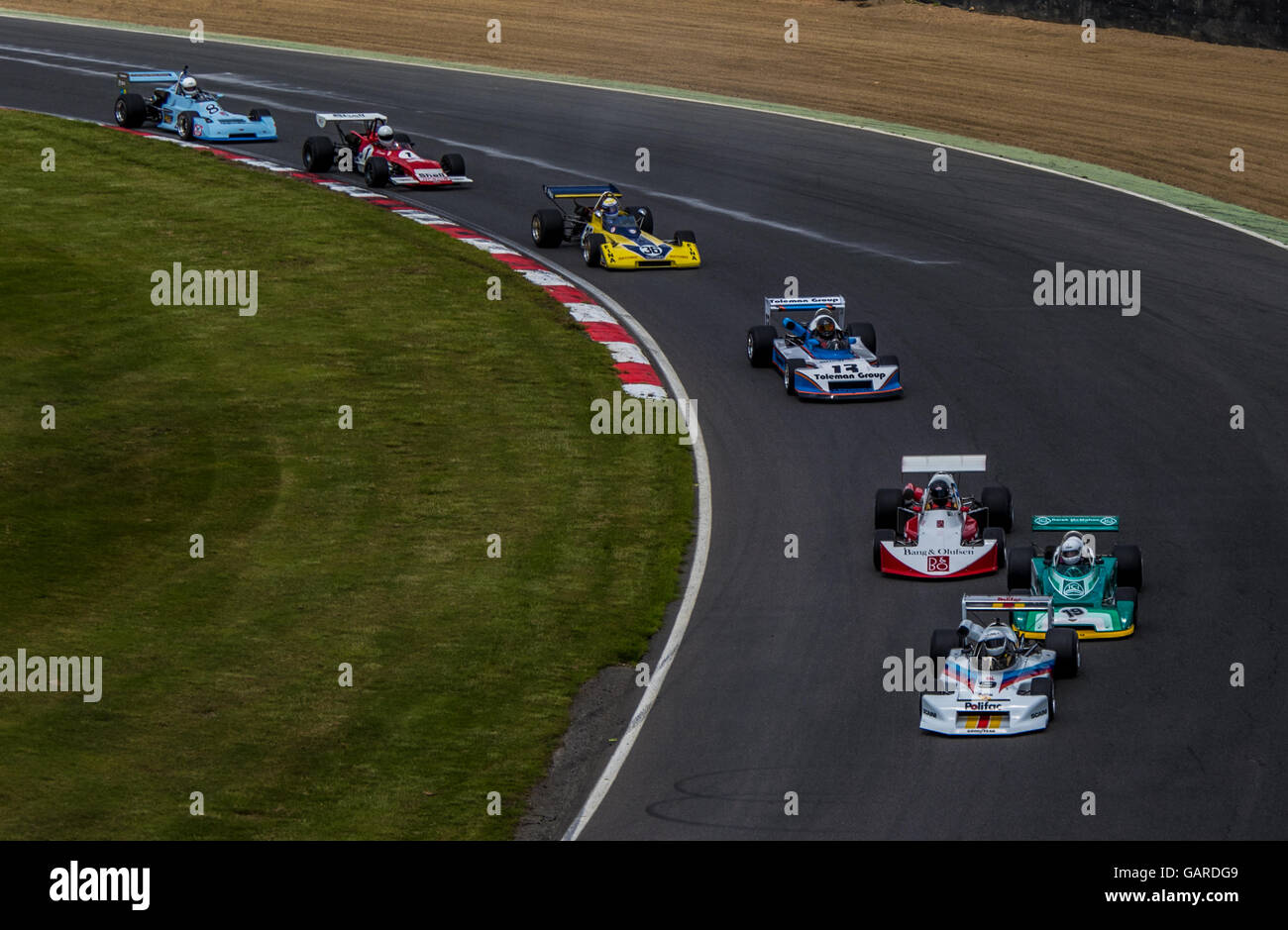 Historic F2 cars round Paddock Hill bend at Brands Hatch, Legends of Brands Hatch meeting, Historic F2 FIA International - Stock Image