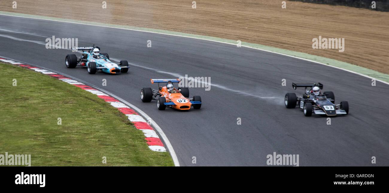 Cars racing on track at Brands Hatch, Historic F2 FIA International Series, Legends of Brands Hatch Superprix - Stock Image