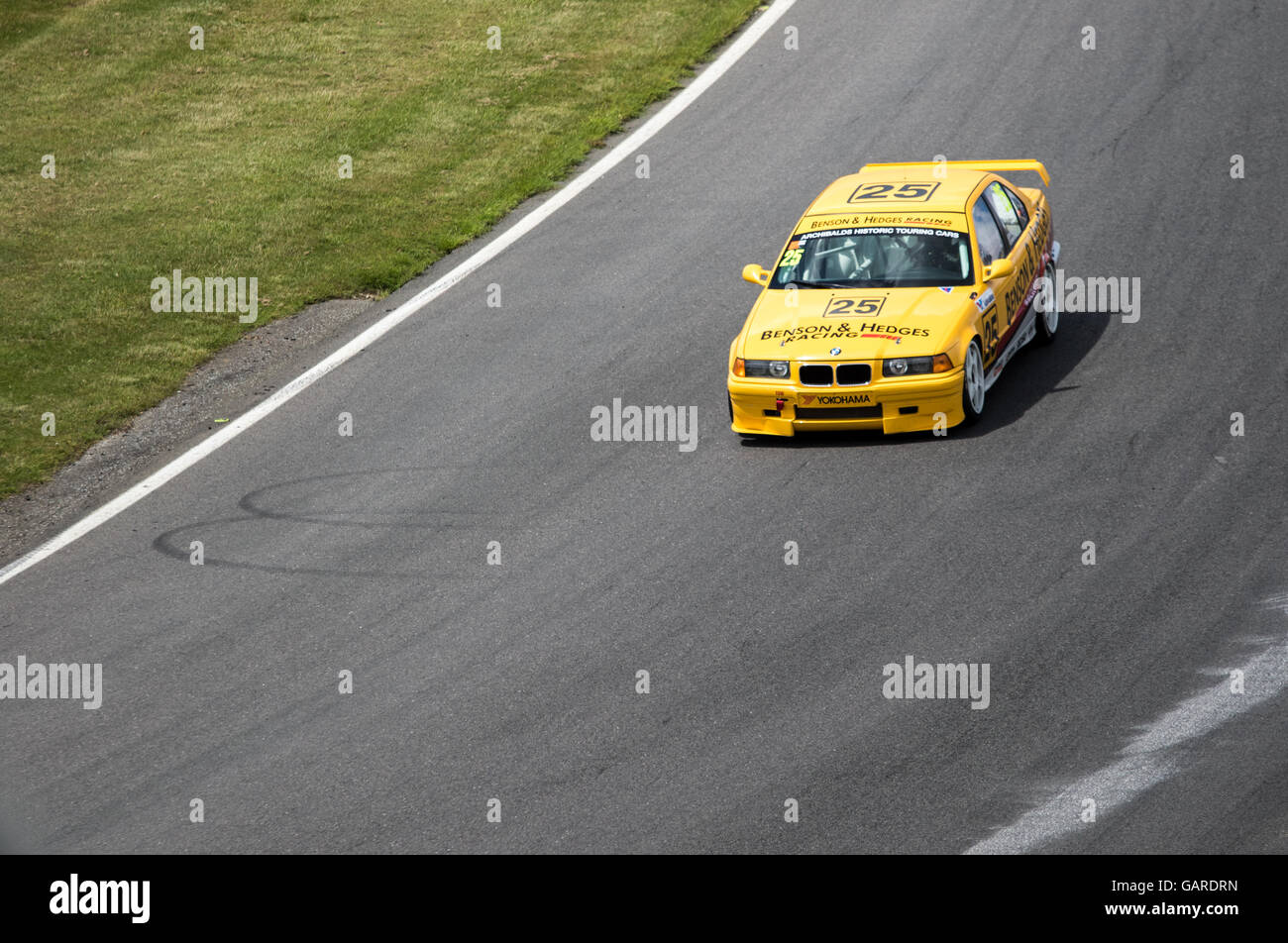 Yellow 1993 BMW 318 on track at Brands Hatch for the Super Touring Car Challenge race - Stock Image