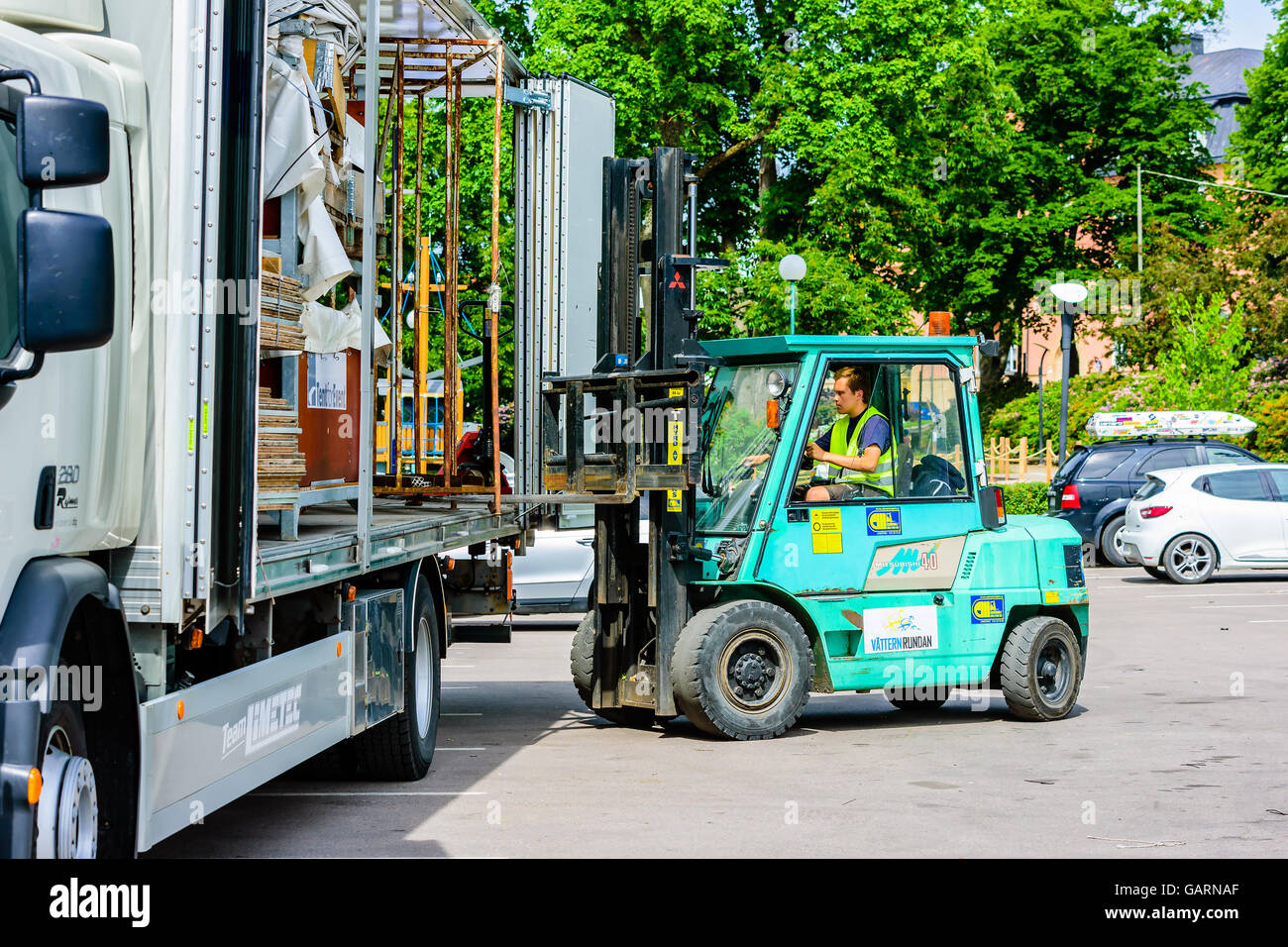 Motala Sweden - June 21 2016: Worker load or unload a steel cage Stock Photo: 109930423 - Alamy