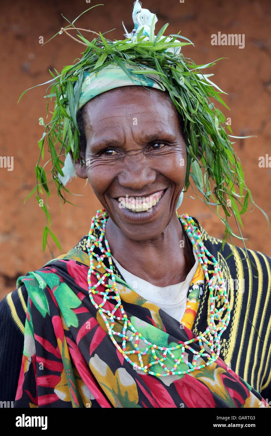 Professional circumciser still practicing female genital mutilation in her traditional circumcision costume. Nakuru, - Stock Image
