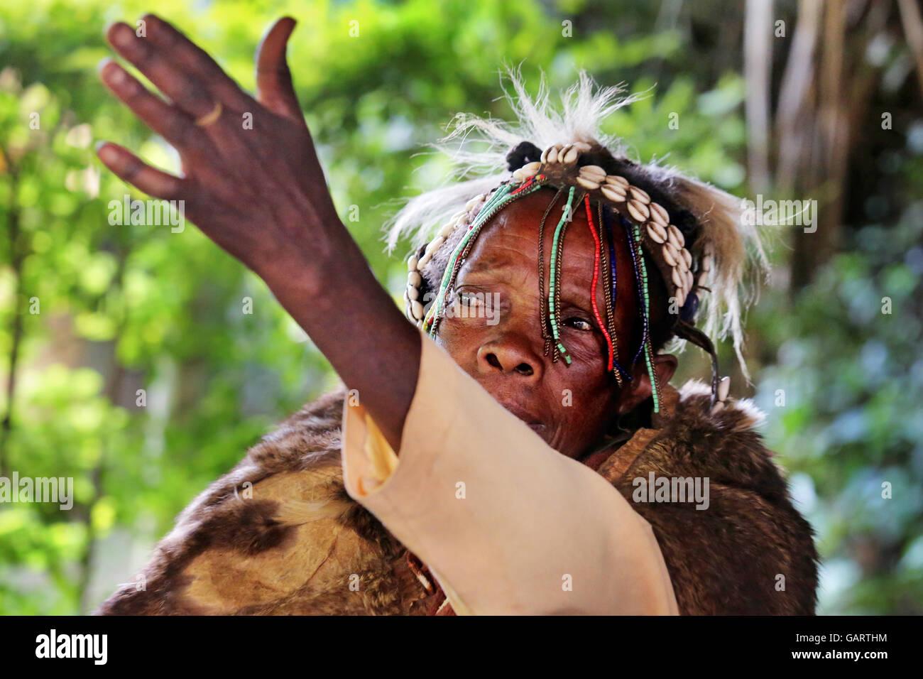 Professional circumciser still practicing female genital mutilation (FGM) in her traditional circumcision costume. - Stock Image