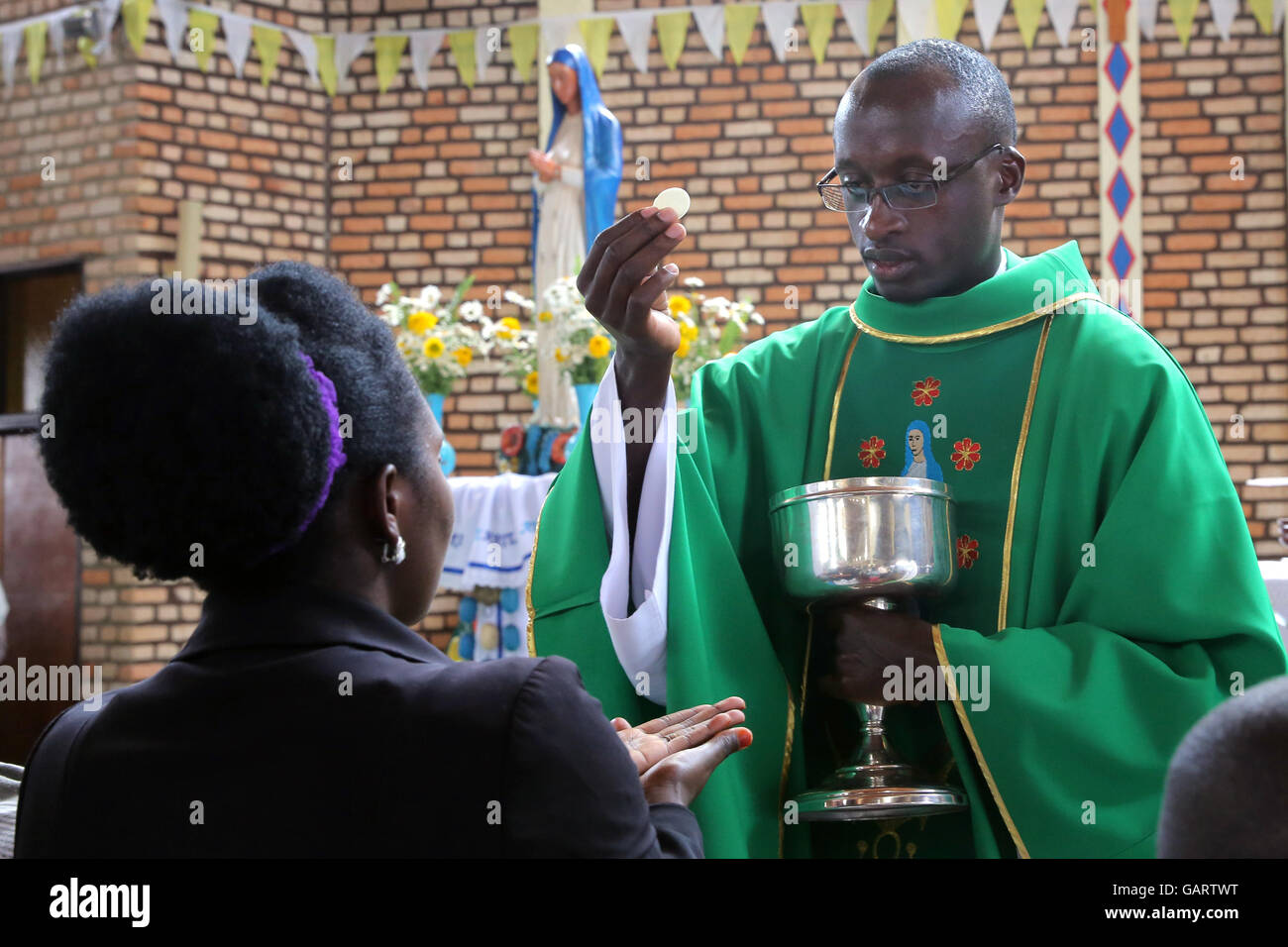 Sunday Mass in the church of the pilgrimage town KIBEHO in Rwanda, Africa. In 1981 the 'Virgin Mary', mother - Stock Image
