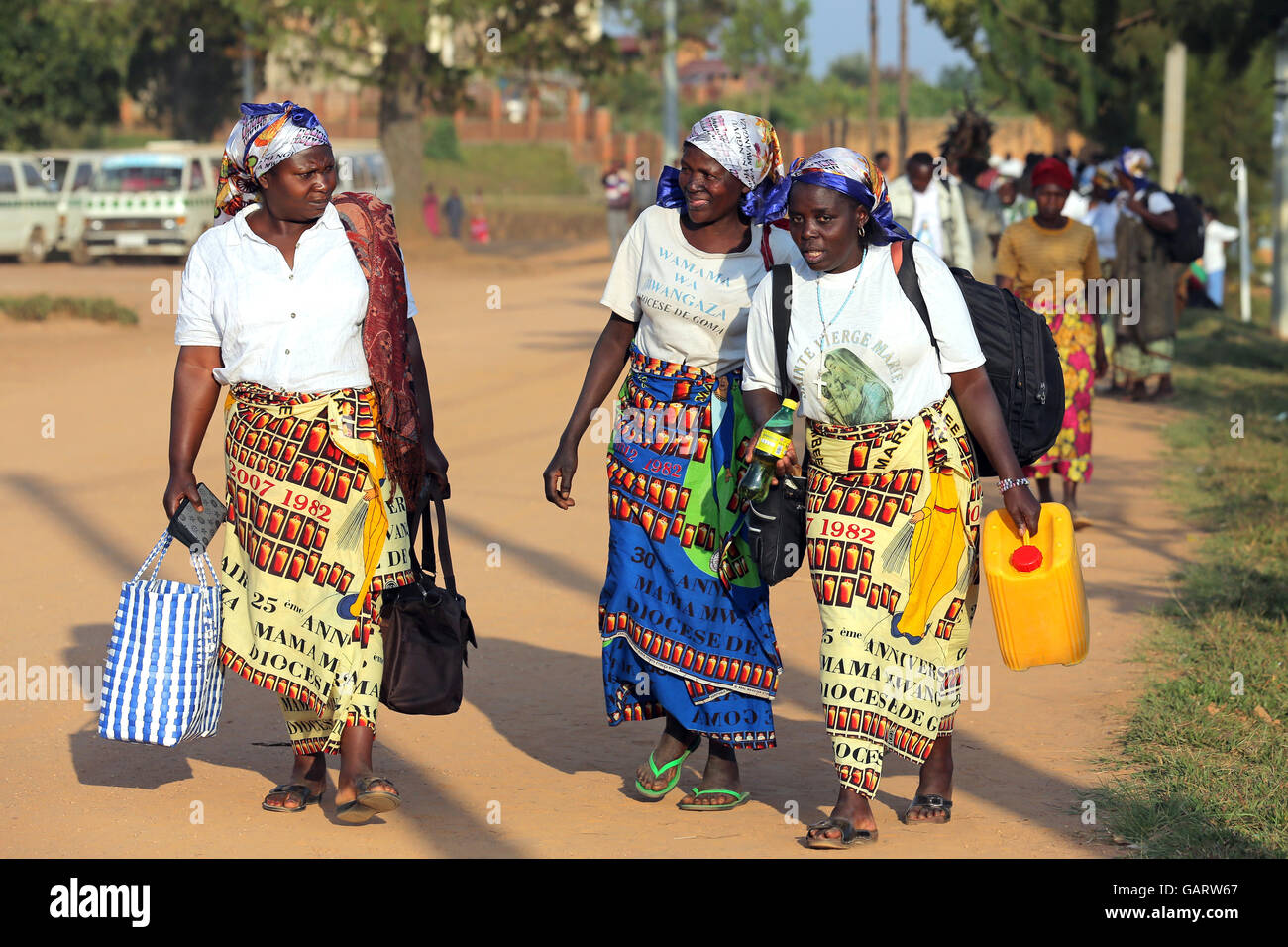 Pilgrims from Congo carry containers of holy water at the pilgrimage site Kibeho in Rwanda. In 1981 the 'Virgin - Stock Image