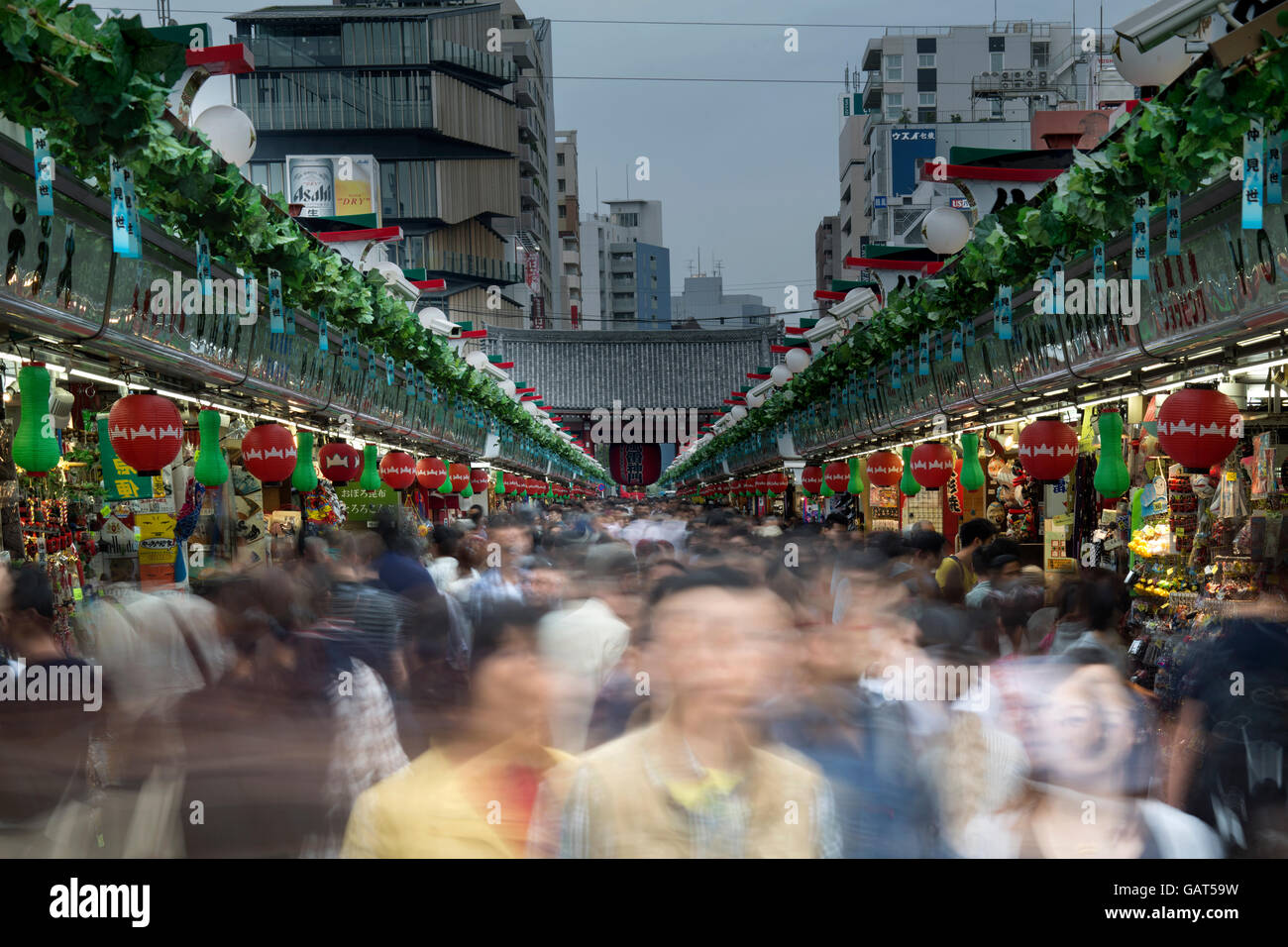 rush of people at a crowded market in tokyo, japan - Stock Image