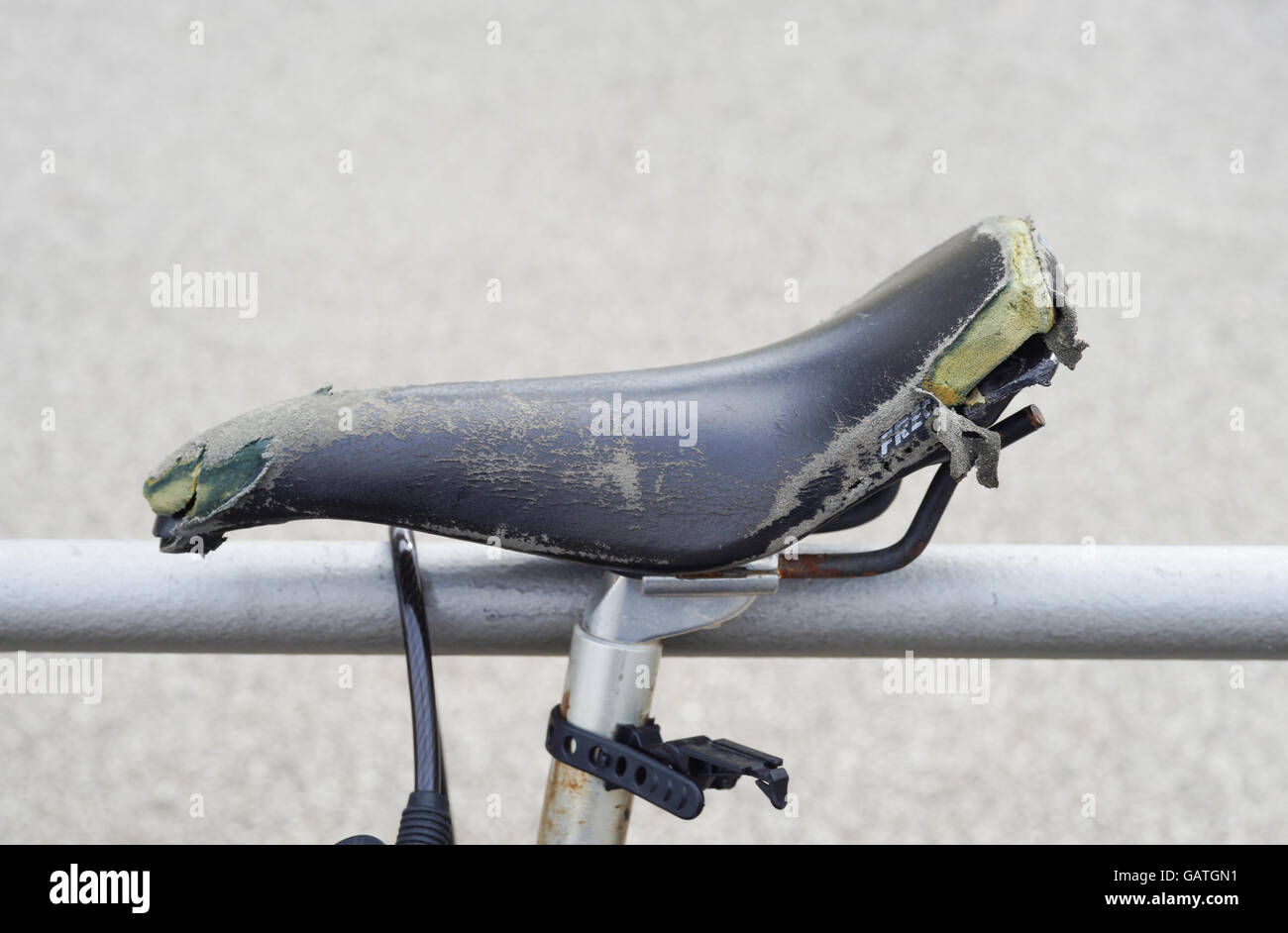 worn bicycle saddle Stock Photo