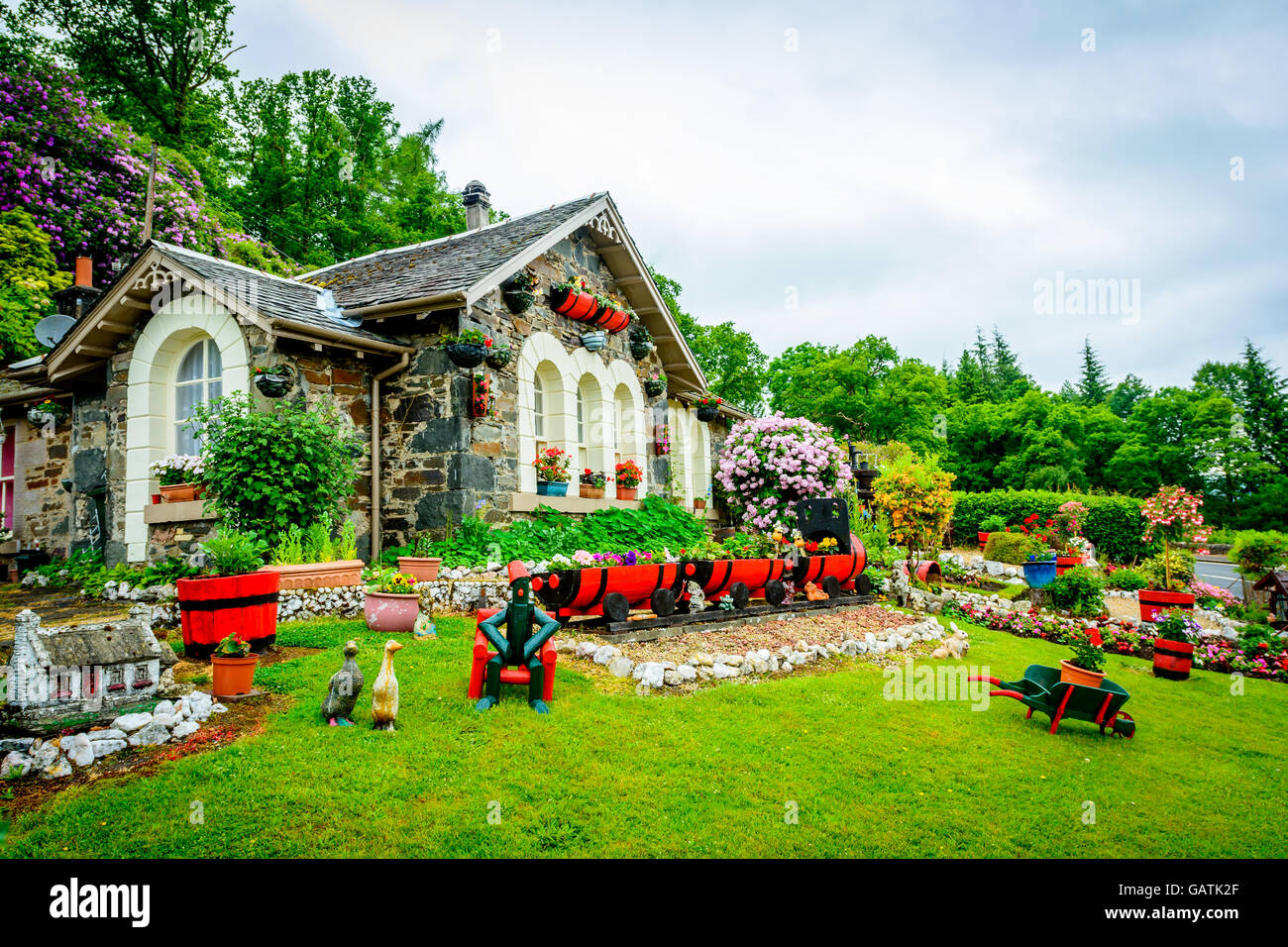 Pretty house in the village of Luss in Loch Lomond and Trossachs National Park in Scotland, United Kingdom - Stock Image