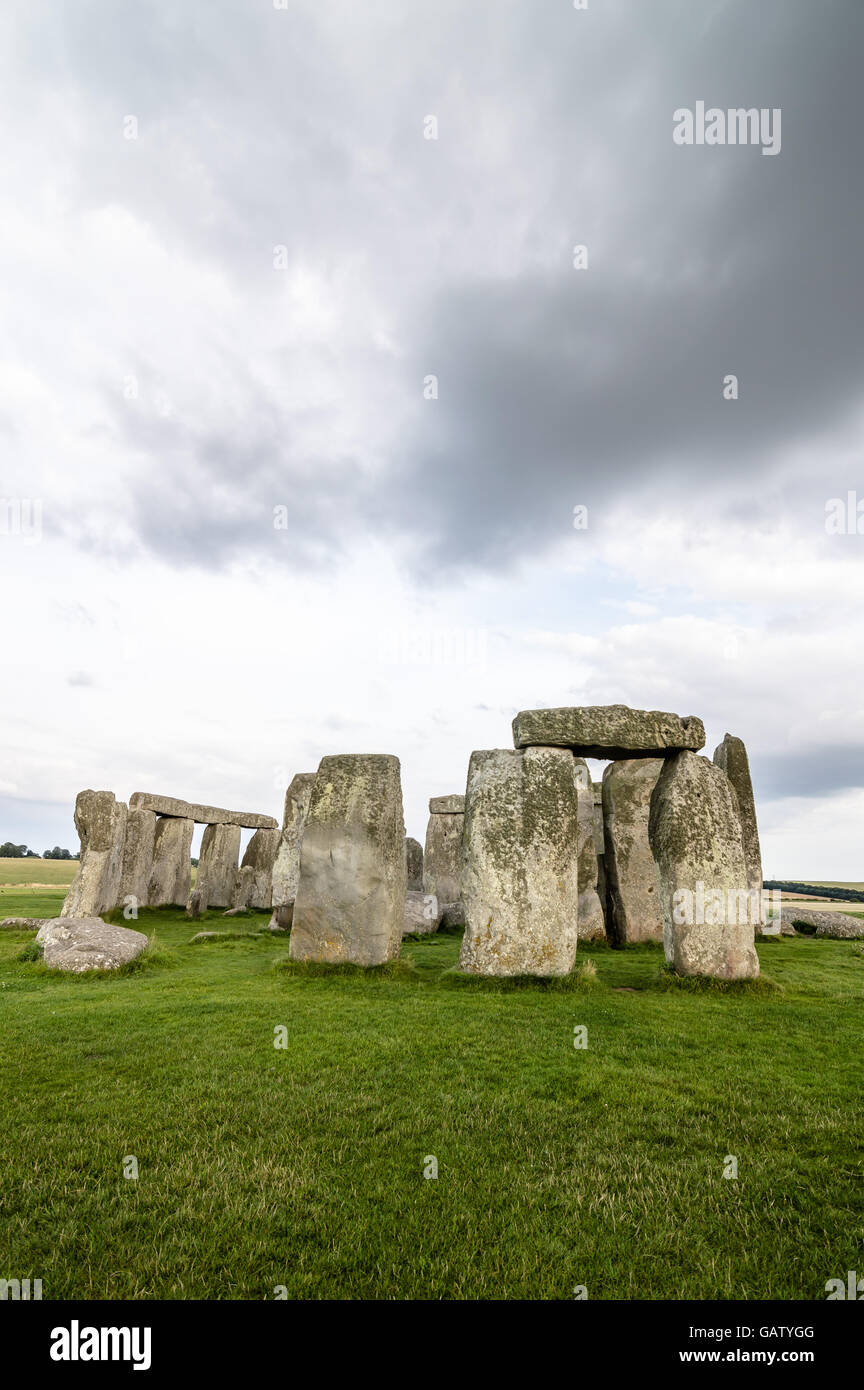 Stonehenge a cloudy day at dusk. Stonehenge is a prehistoric monument made of a ring of standing stones - Stock Image