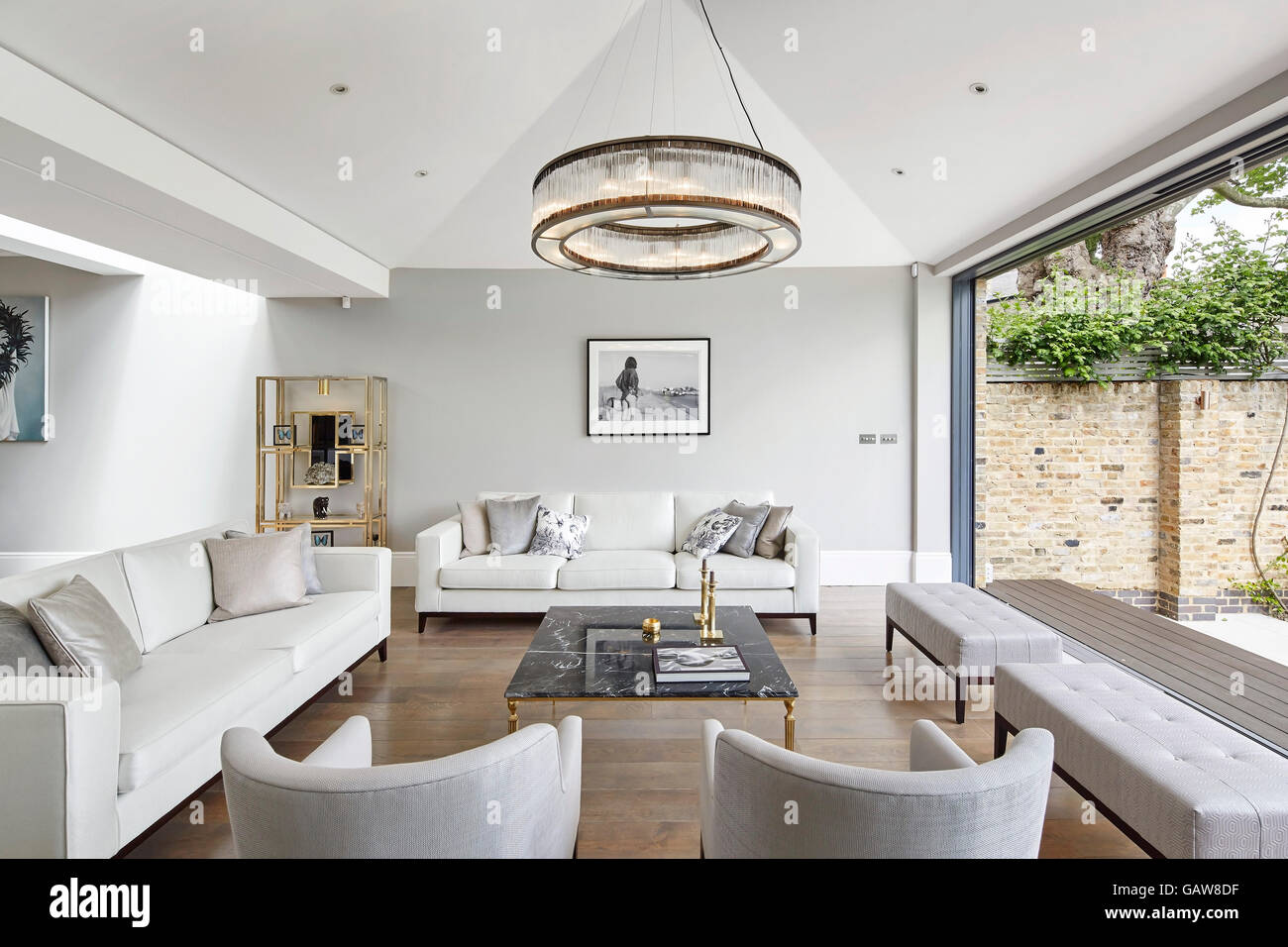 Reception room with open sliding doors to garden. Private House ...