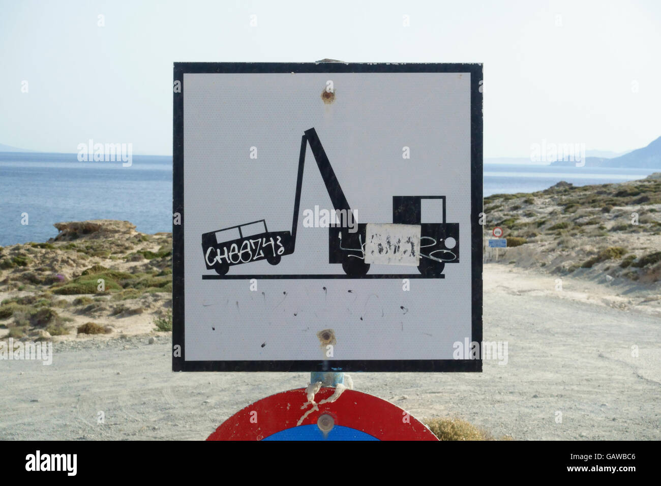 A very simple road sign on the coast of Milos Greece - Stock Image
