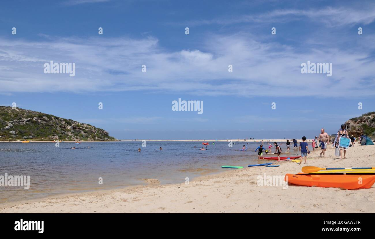 Guilderton,WA,Australia-October 3,2015:Beach with tourists and kayaks on the Moore River with sandbar to Indian - Stock Image