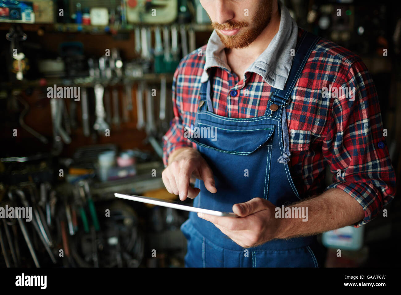 Repairman with touchpad - Stock Image