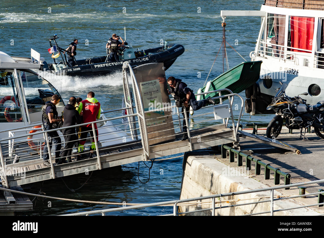 Paris, France. 5th July, 2016. A man is being evacuated from Seine river by fireman and policemen. Credit:  Guillaume - Stock Image