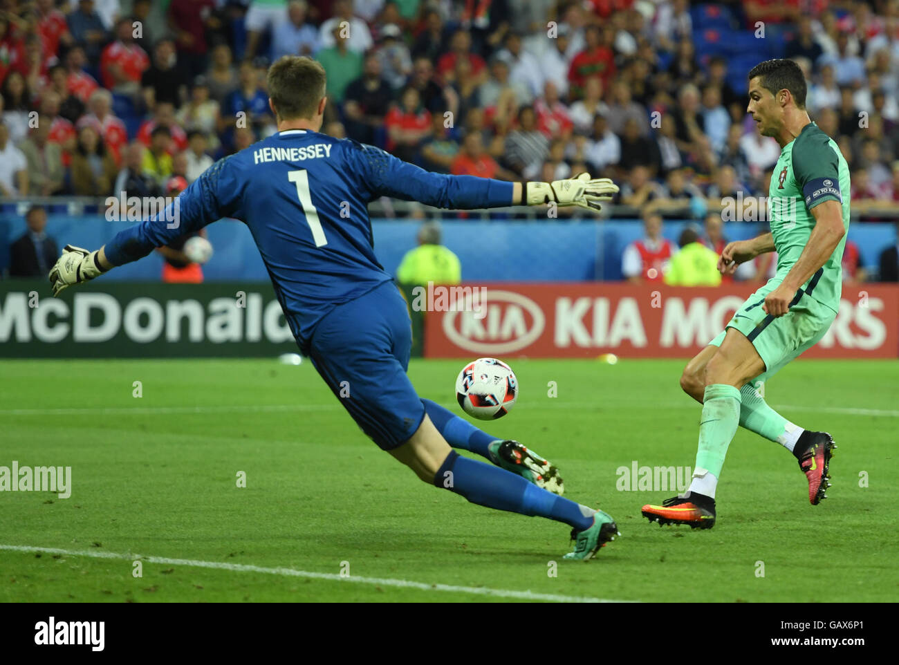 Lyon, France. 06th July, 2016. Cristiano Ronaldo of Portugal and goalkeeper Wayne Hennessey (L) of Wales vie for Stock Photo