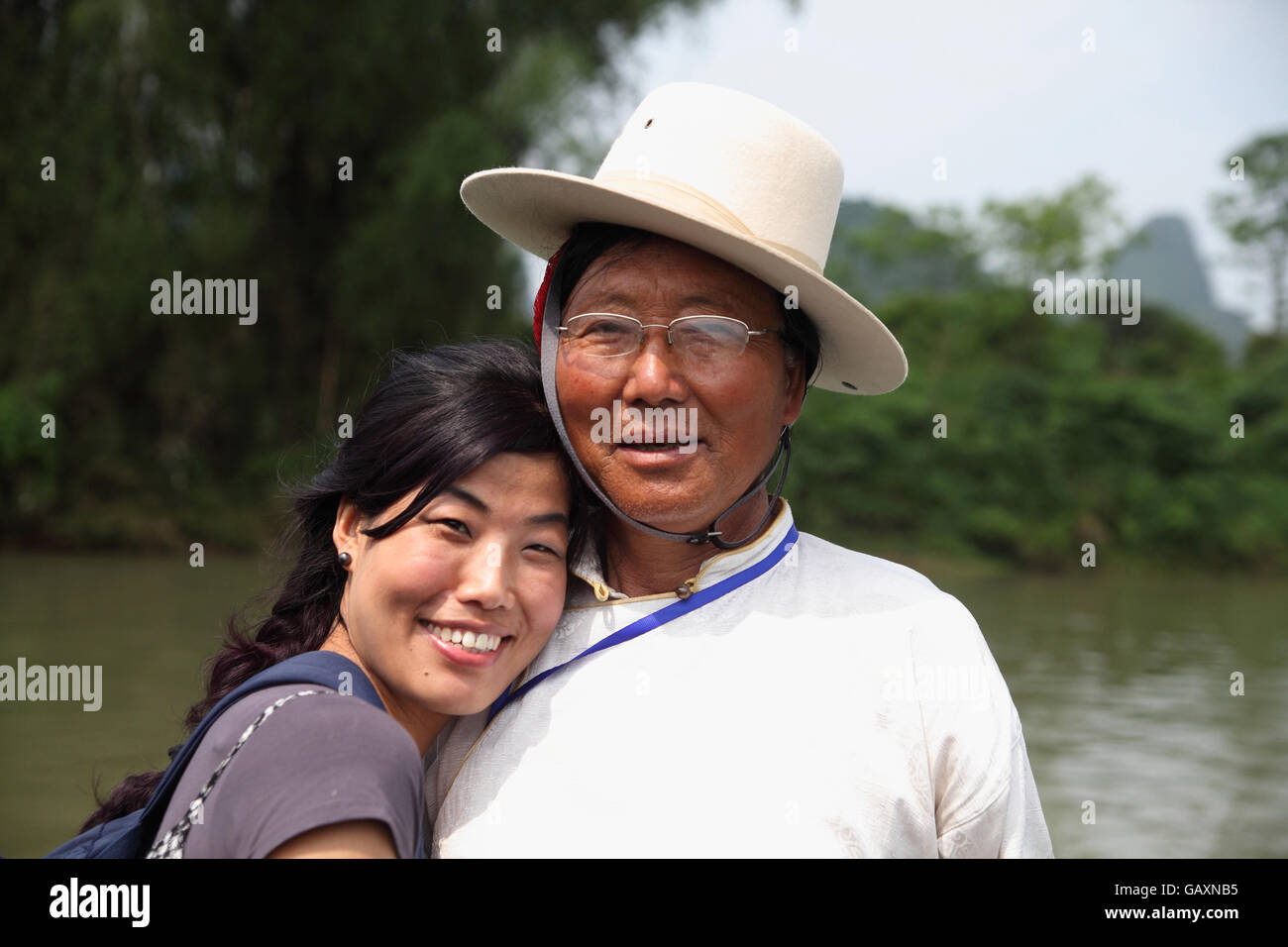 A candid portrait of a Tibetan man and a younger woman who is half Tibetan and half Muslim Hui. Li River near Yangshuo, - Stock Image