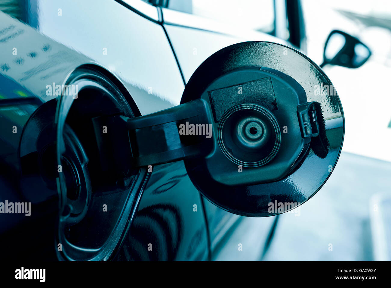 closeup of the fill cap of the fuel tank of a car - Stock Image