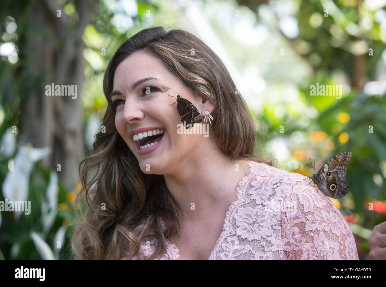 Actress,TV presenter and model in the butterfly Dome at RHS Hampton Court.She poses with a butterfly on her face - Stock Image