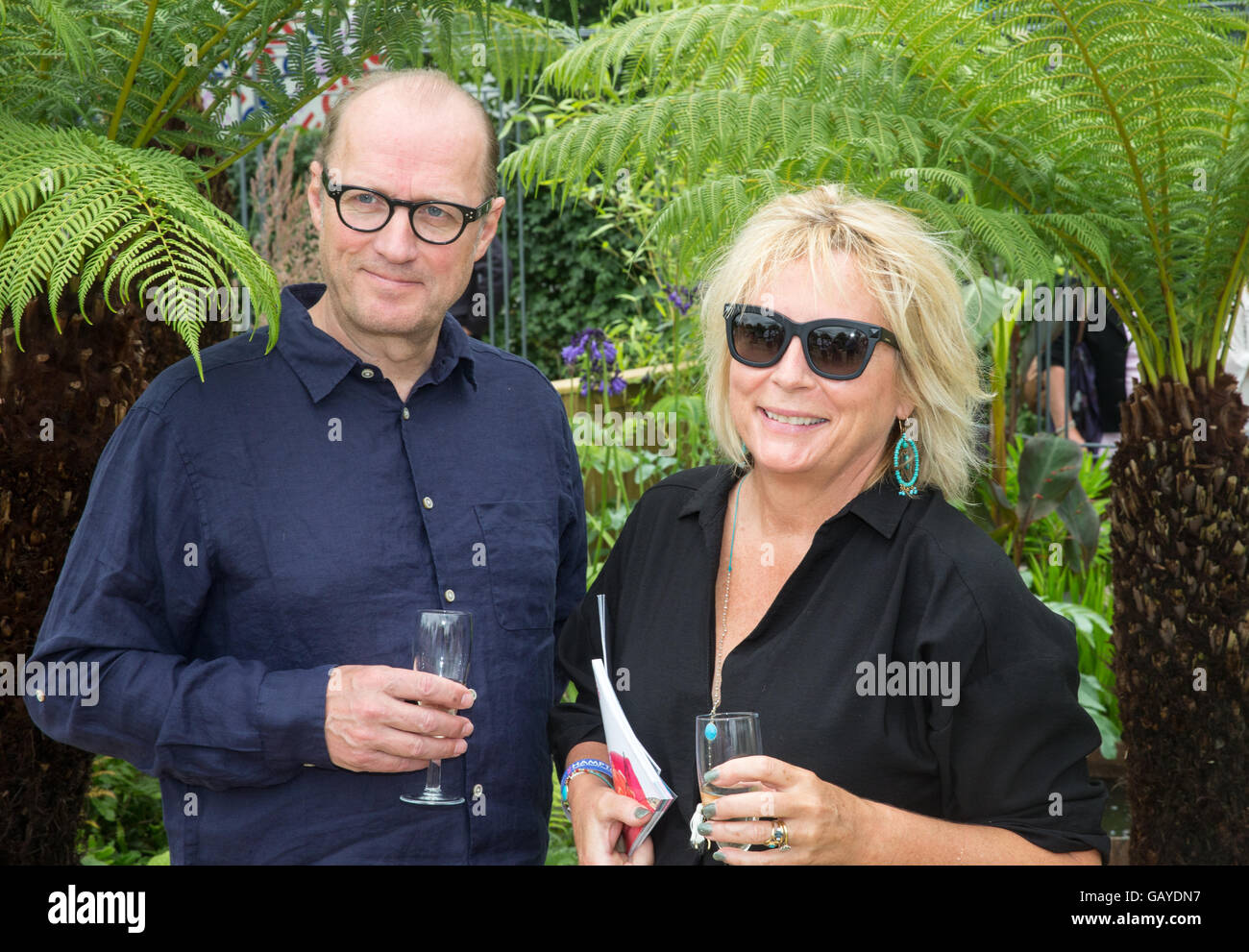 Absolutely Fabulous creator Jennifer Saunders, attends RHS Hampton Court Palace Flower Show with her husband Ade - Stock Image