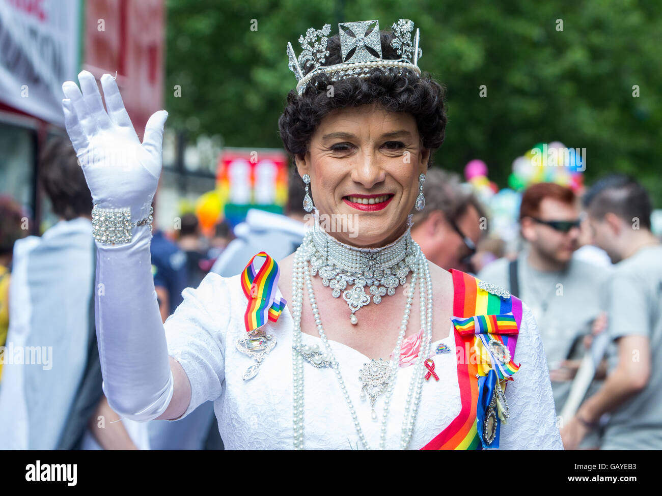 A person dressed as a Queen waving at the  Pride parade in London 2016 - Stock Image