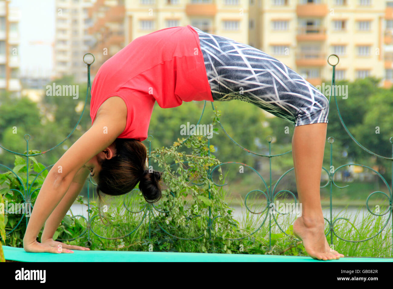 Young Indian Woman Performing Chakrasana Or The Wheel Pose In Yoga Stock Photo Alamy