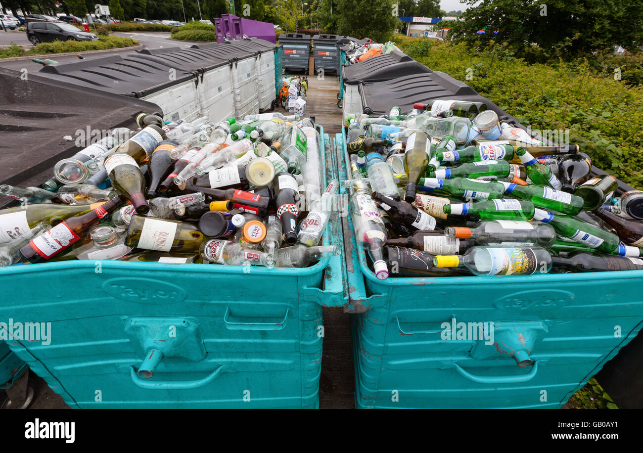 Overflowing recycling glass bottle bank in Winchester, UK - Stock Image