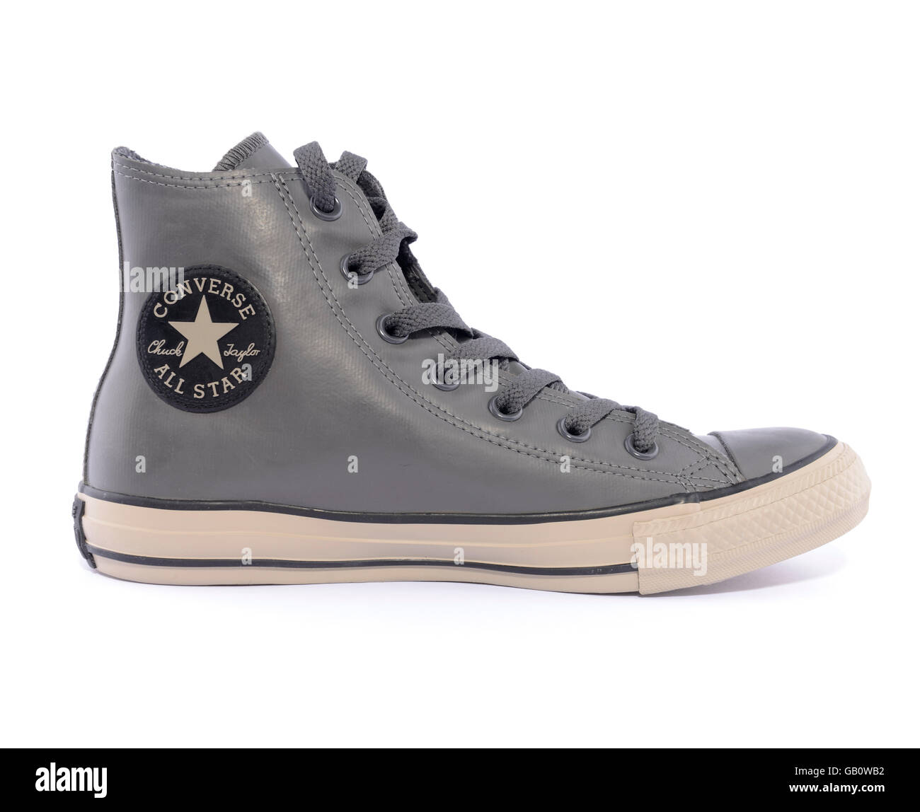 9a97a26c30df Side view of a Converse Chuck Taylor All Star rubber sneaker isolated on  white background -