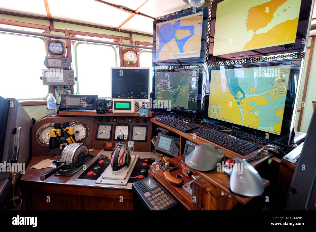 Navigation room with high tech cartography equipment on a freight ship - Stock Image