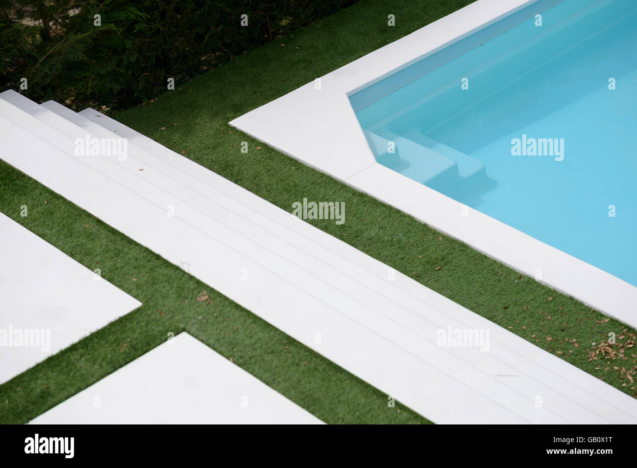 Aerial view of an outdoor swimming pool and lawn Stock Photo