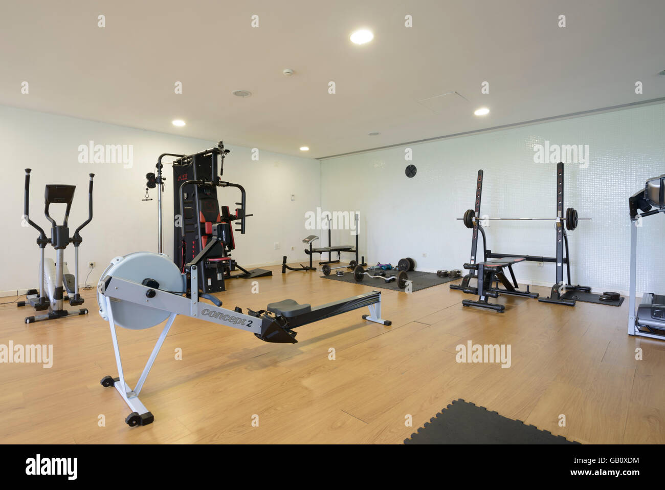 Exercise machines on a home gym - Stock Image