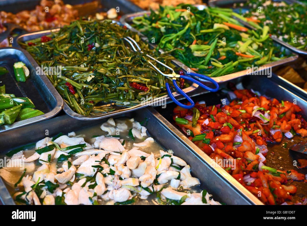 Asia Chinese buffet self serve food in silver trays in Malaysia, Kuala Lumpur - Stock Image