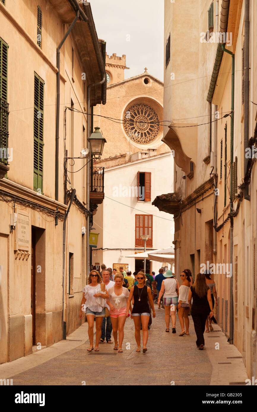 people in Pollensa ( Pollenca ) old town centre, north Mallorca ( Majorca ), Balearic Islands, S[pain Europe - Stock Image