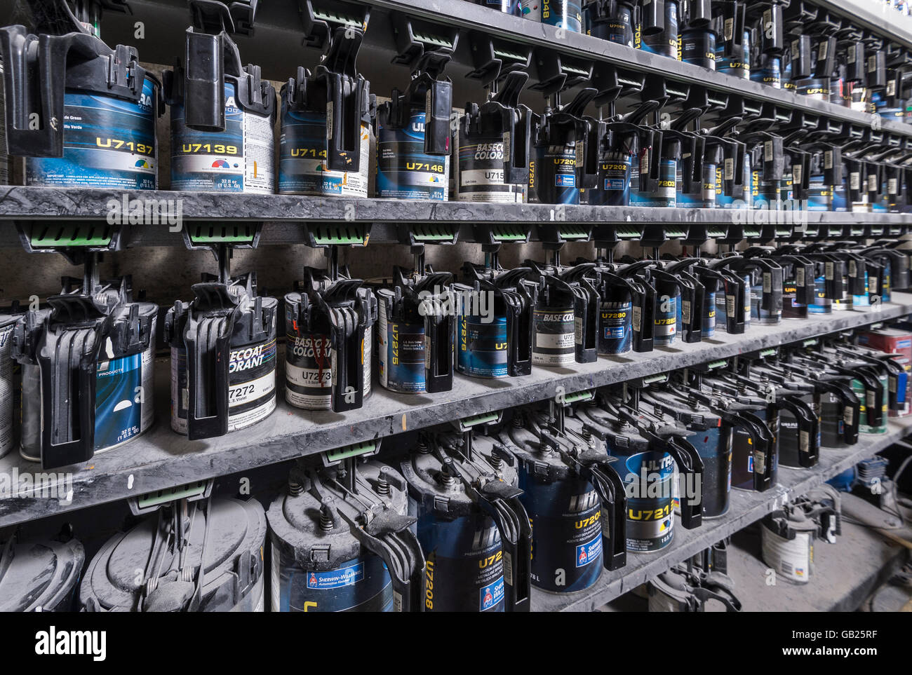 Paint Cannisters In Auto Body Paint Shop - Stock Image