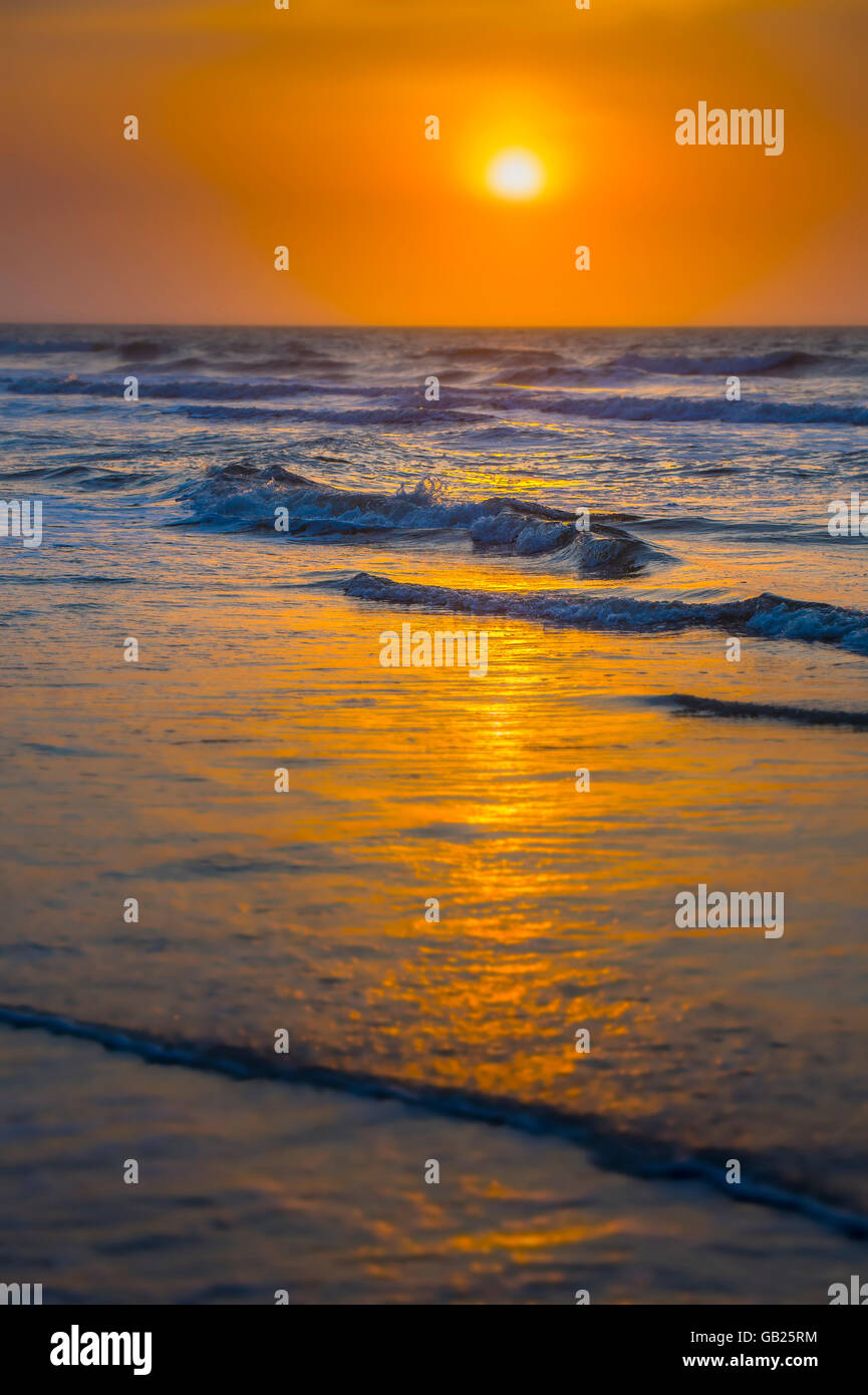 Artistic Ocean Waves & Sunrise With Shallow Focus Stock Photo