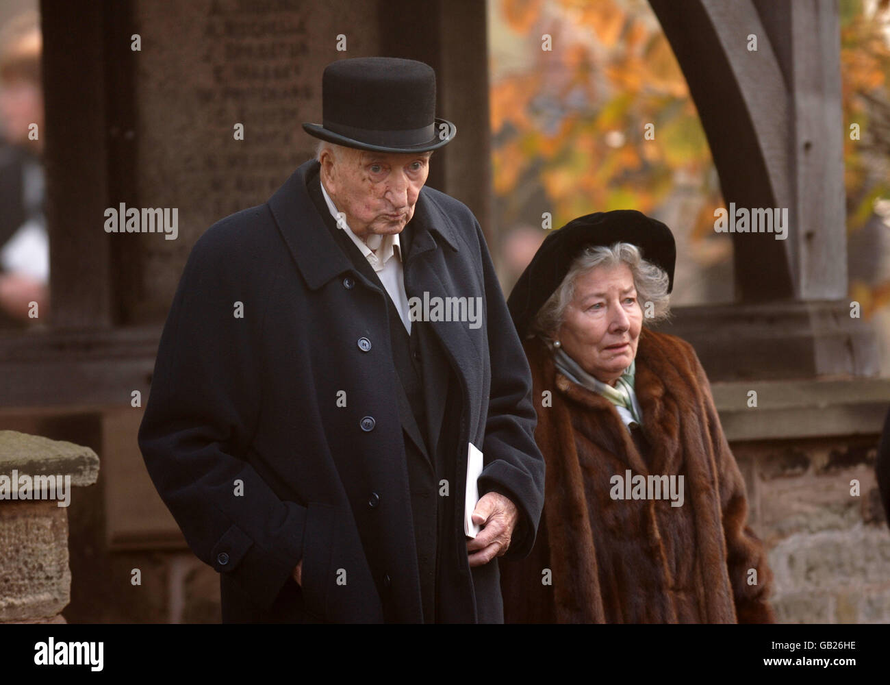 Godfrey Stafford Bostock (1915 - 2008) and his wife Penelope, Dowager Countess of Lindsay at funeral of Patrick - Stock Image
