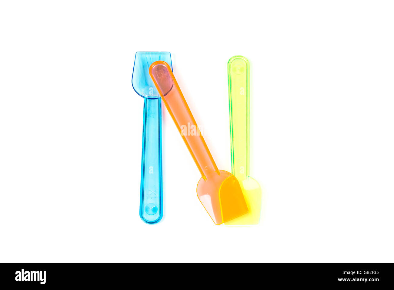 N letter with ice cream spoons - Stock Image